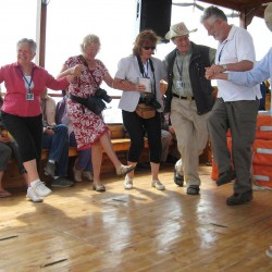 Christian group dancing on a boat Sea of Galilee