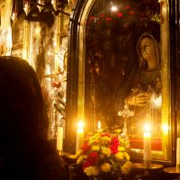 Lighting a candle at the Church of the Holy Sepulcher