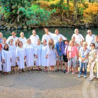 A Christian group tour in the River Jordan