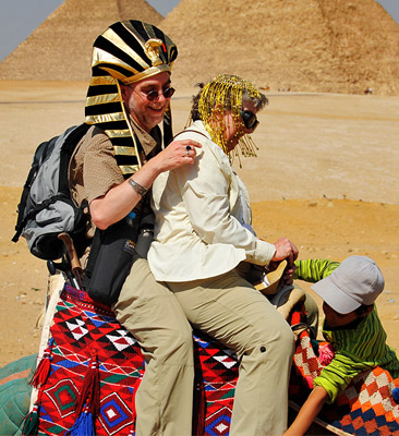 Riding camels near the pyramids in Egypt