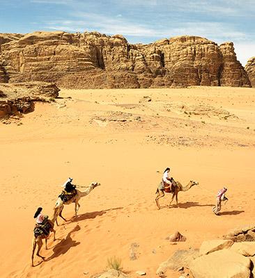 Riding camels in Jordan
