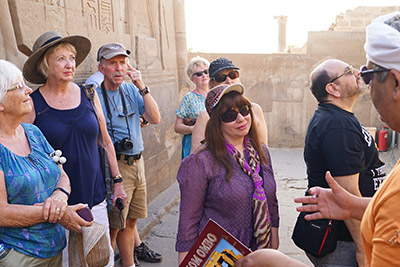 The tour guide is going over the history of this Egyptian ancient site