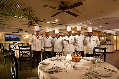 The restaurant staff and chef aboard the Sonesta Moon Goddess cruise
