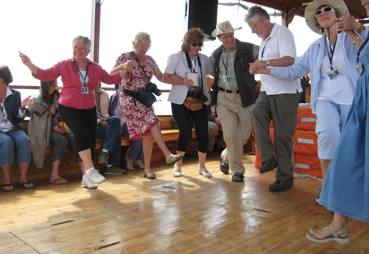 Dancing while on a boat in the Sea of Galilee