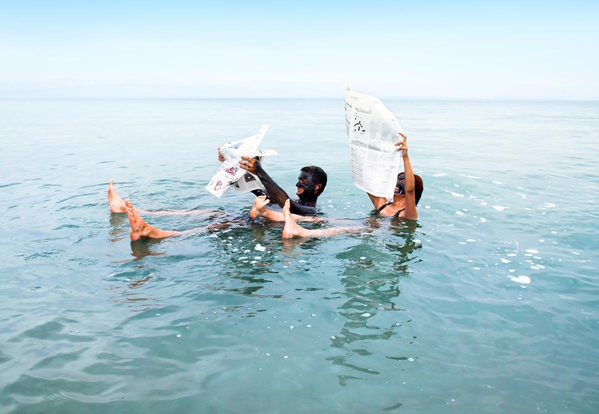 Enjoying a bath in the Dead Sea during a tour