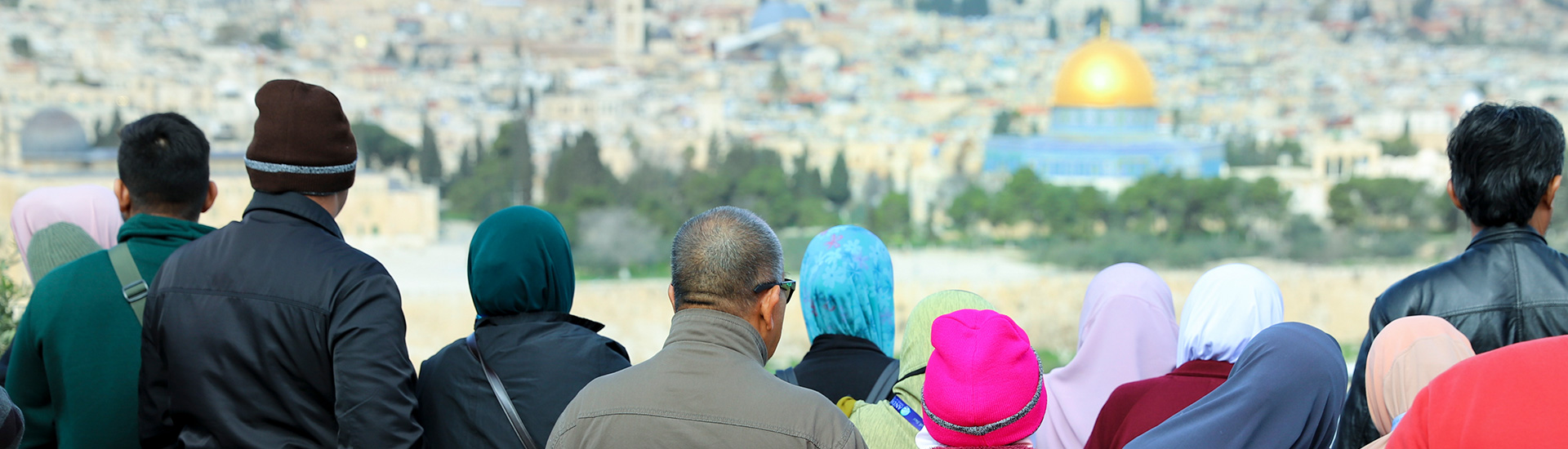 A group posing with Old Jerusalem in the background.