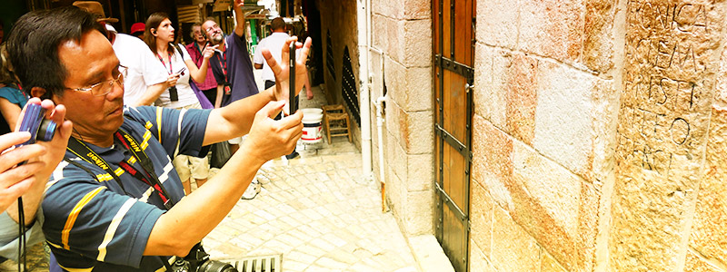 Taking a photo a the Via Dolorosa